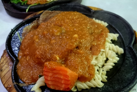 Beef steak with spaghetti gravy