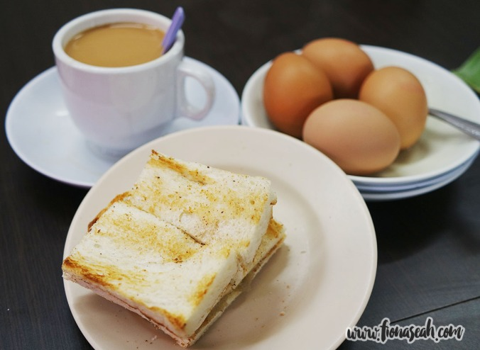 Kaya toast and soft-boiled eggs with a cup of Teh