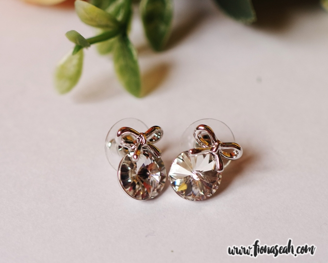 Austrian Crystal Bowknot Round White Ear Studs, was on offer at S$19.53