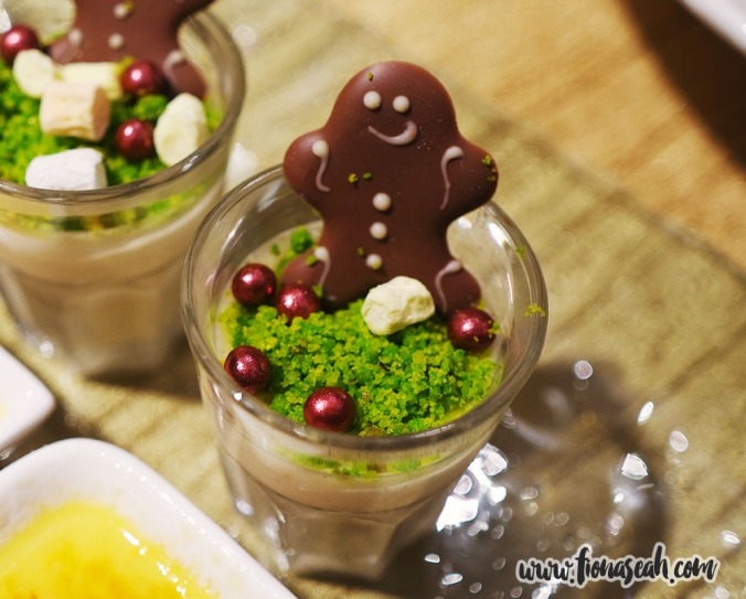 Gingerbread man atop white chocolate and cinnamon