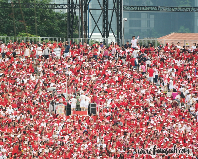 The crowd dressed in red and white