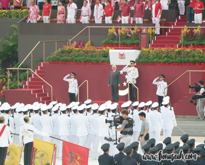 President Tony Tan standing on the saluting dais
