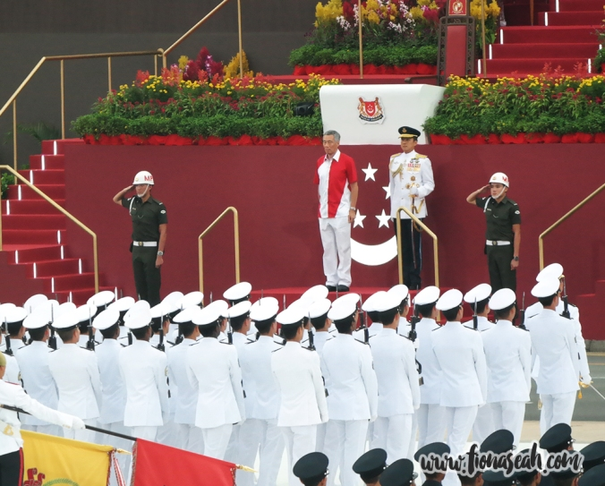 PM Lee standing on the saluting dais