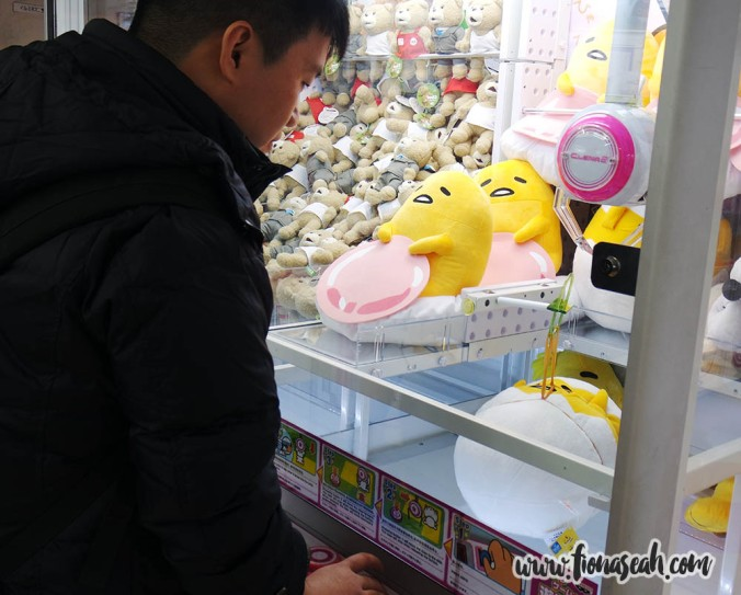 On our way back to the JR station, we stopped by a huge arcade with many toy catcher machines. Boyfriend tried his luck at one and successfully got a mid-sized Gudetama after several tries lol