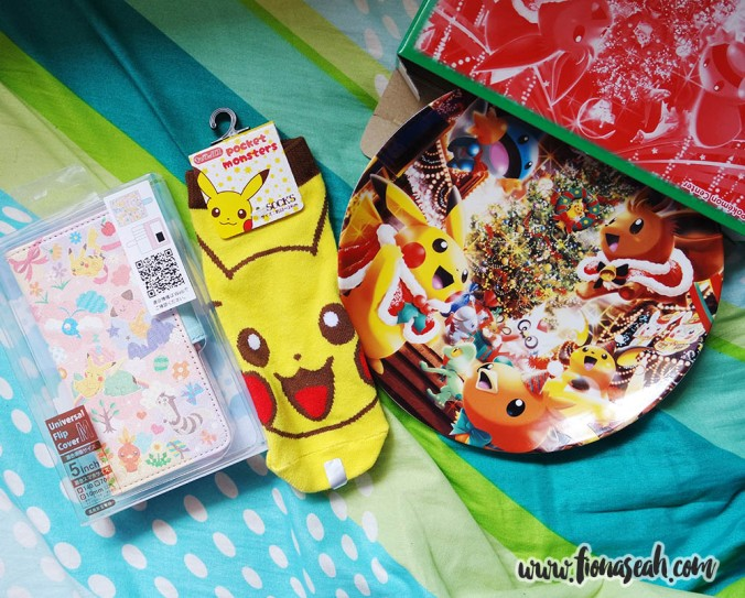 Universal handphone flip cover with slots for cards (left) and porcelain plate from Pokemon Center Mega Tokyo! Pikachu socks from one of the shops at Harajuku