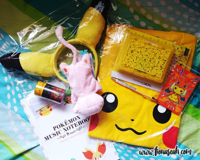 Pikachu headgear, notebooks, cartridge holder, card holder, Pikachu T-shirt, miniature Mew plushie (which ran out of stock really fast!) and more sticky tape rolls from Pokemon Center Mega Tokyo!
