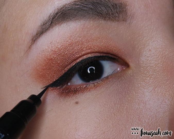 Classic eyeliner flick