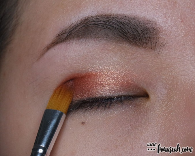 Define the eye by adding a darker shade on the outer corner