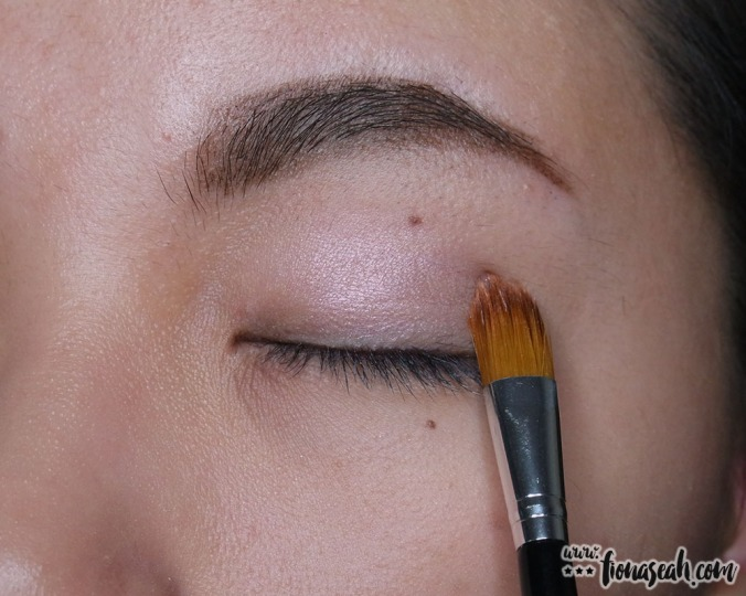 Apply the base colour all over lids with the shader side of the dual-ended brush
