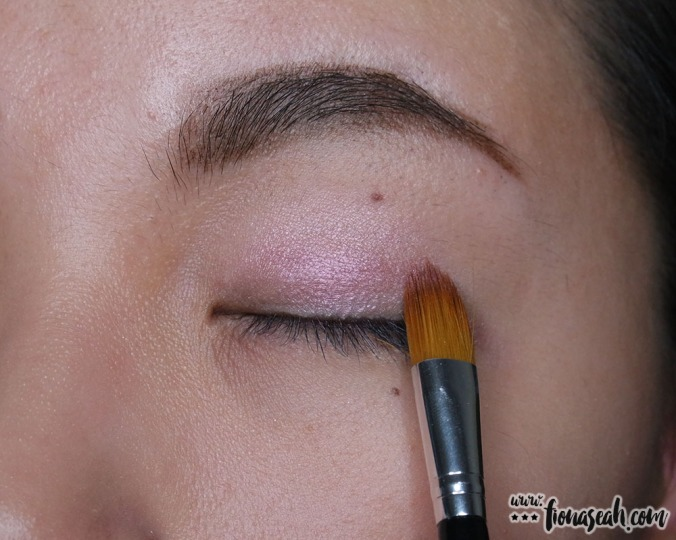 With the same end of the brush, apply the styling shade above the base