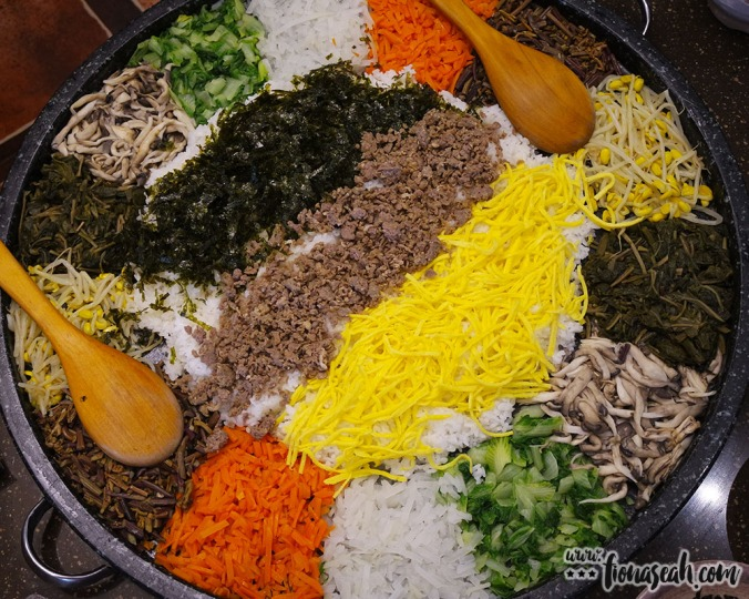 A gigantic stone bowl of bibimbap (minus the sunny side up) to be shared among a table of 8-10