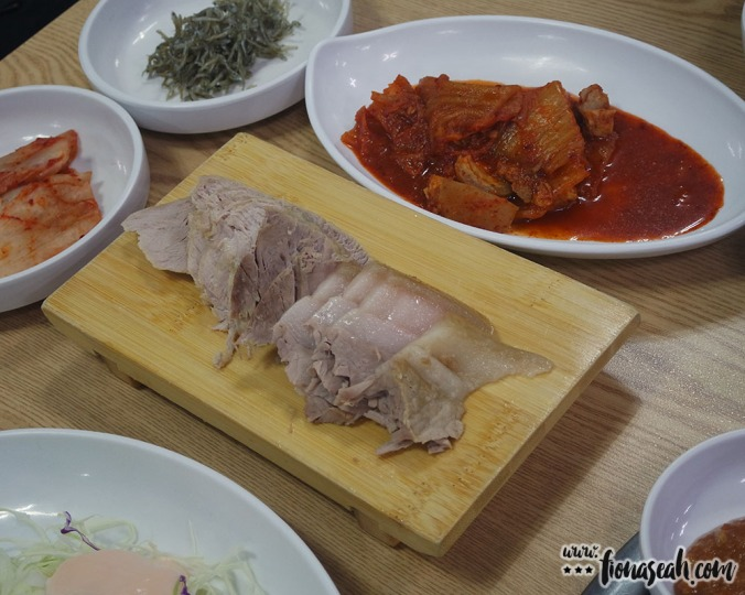 Other banchan dishes. I can't remember what the middle one is... Maybe chicken?