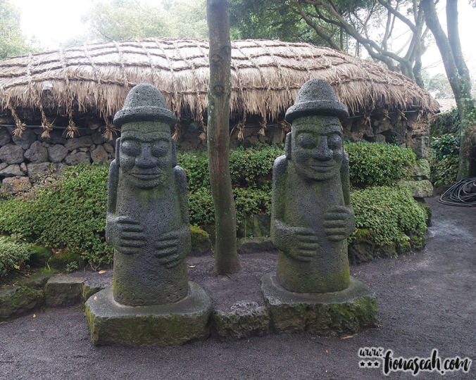 The dol hareubang, a large rock statue said to offer both protection and fertility to the household, is a common sight in Jeju