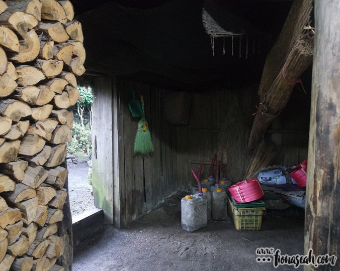 Inside one of the vacant thatched huts.. now just a storage space
