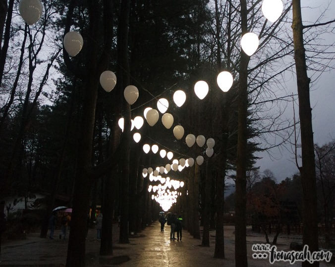 Tree-lined pavement with lamps in the shape of balloons illuminating from above the moment dusk set in. Our tour guide actually took a picture of fiancé and me against these trees but it turned out awful.. I looked so fat in my pink Taobao winter coat 😭