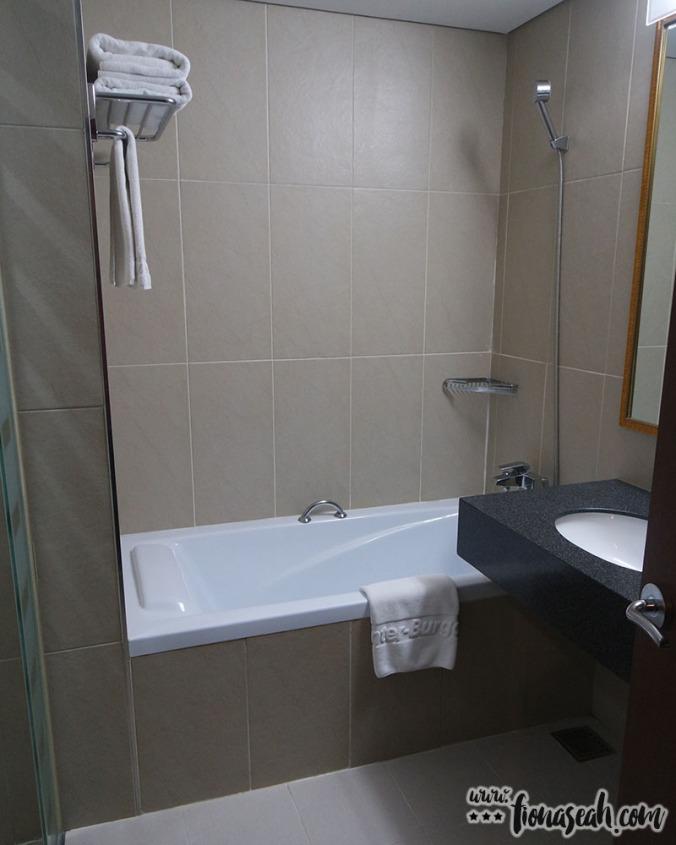 Bathtub and an additional shower head