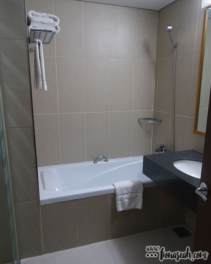 Bathtub and an additional shower head