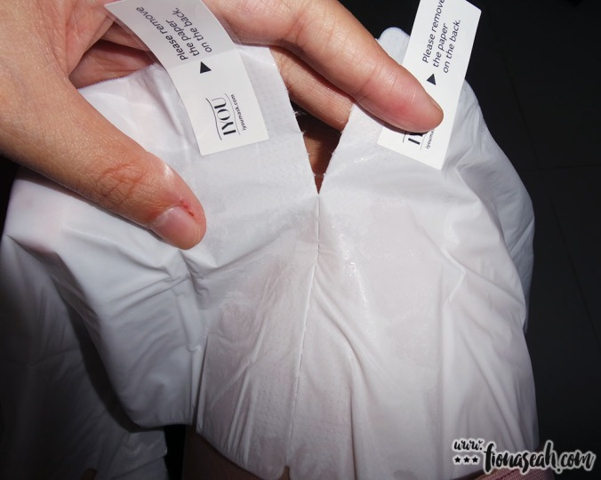 Tear along the perforated lines to separate the gloves (the essence is sealed inside the gloves)