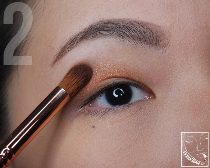 Blend it with soft champagne gold to create a little ombré effect towards the brows