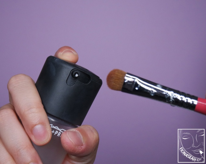 Wetting the brush so that the shade would be more prominent on my lids