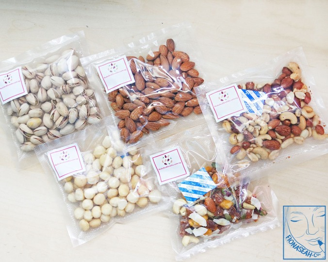 [100g packs] From bottom left, in anti-clockwise direction: Natural Macadamia Nuts, Tropical Trail Mix, Roasted Salted Mixed Nuts, Roasted Almonds (unsalted), Pistachio Nuts Roast (salted).